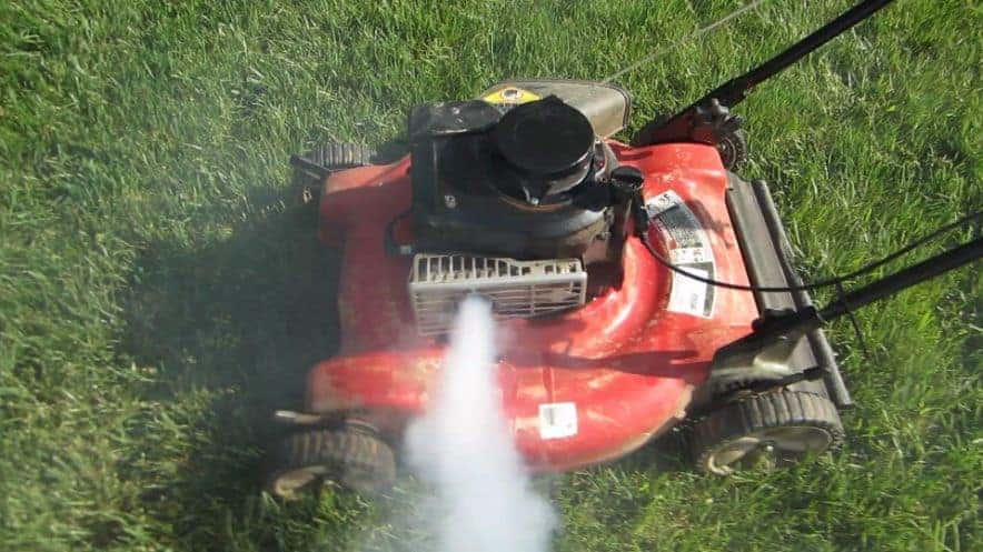 (image of a lawn mower engine smoking)