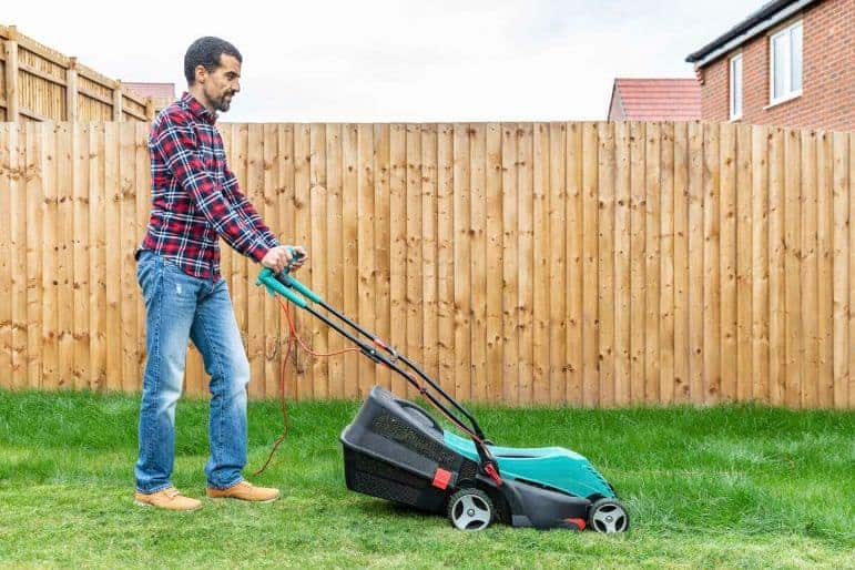 (image of a person mowing a lawn)