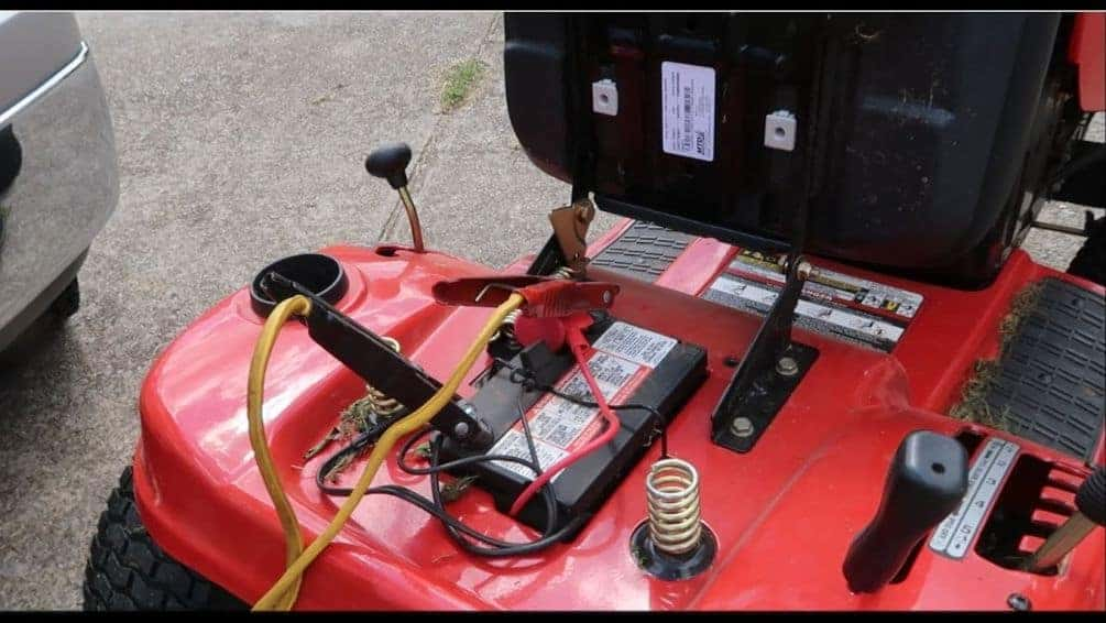 (image of jumper cables connected to lawn mower battery)